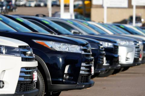 A long row of unsold used Highlander sports-utility vehicles is seen at a Toyota dealership in ...