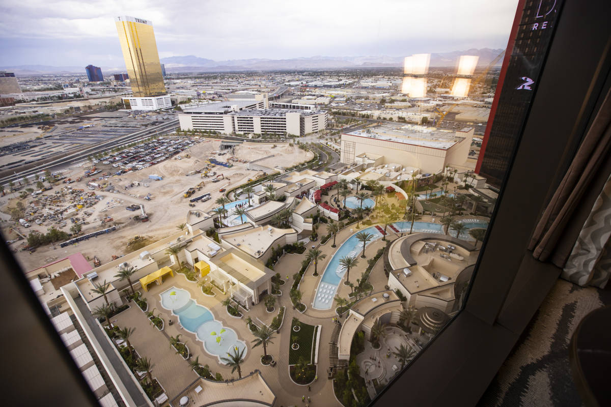 A view of the pool area and beyond is seen from a Conrad suite during a tour of Resorts World a ...