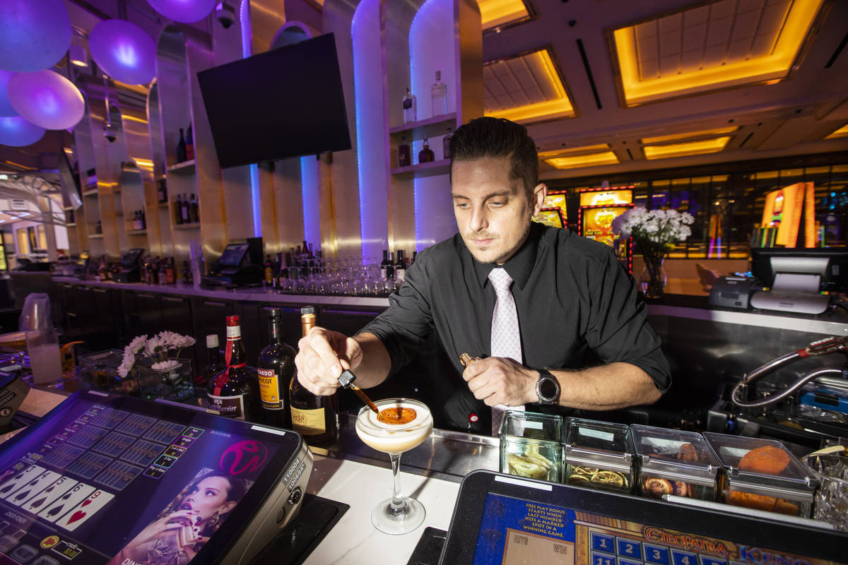 Lead bartender Michael Giambrone prepares the Old Sport cocktail at Gatsby's cocktail lounge du ...