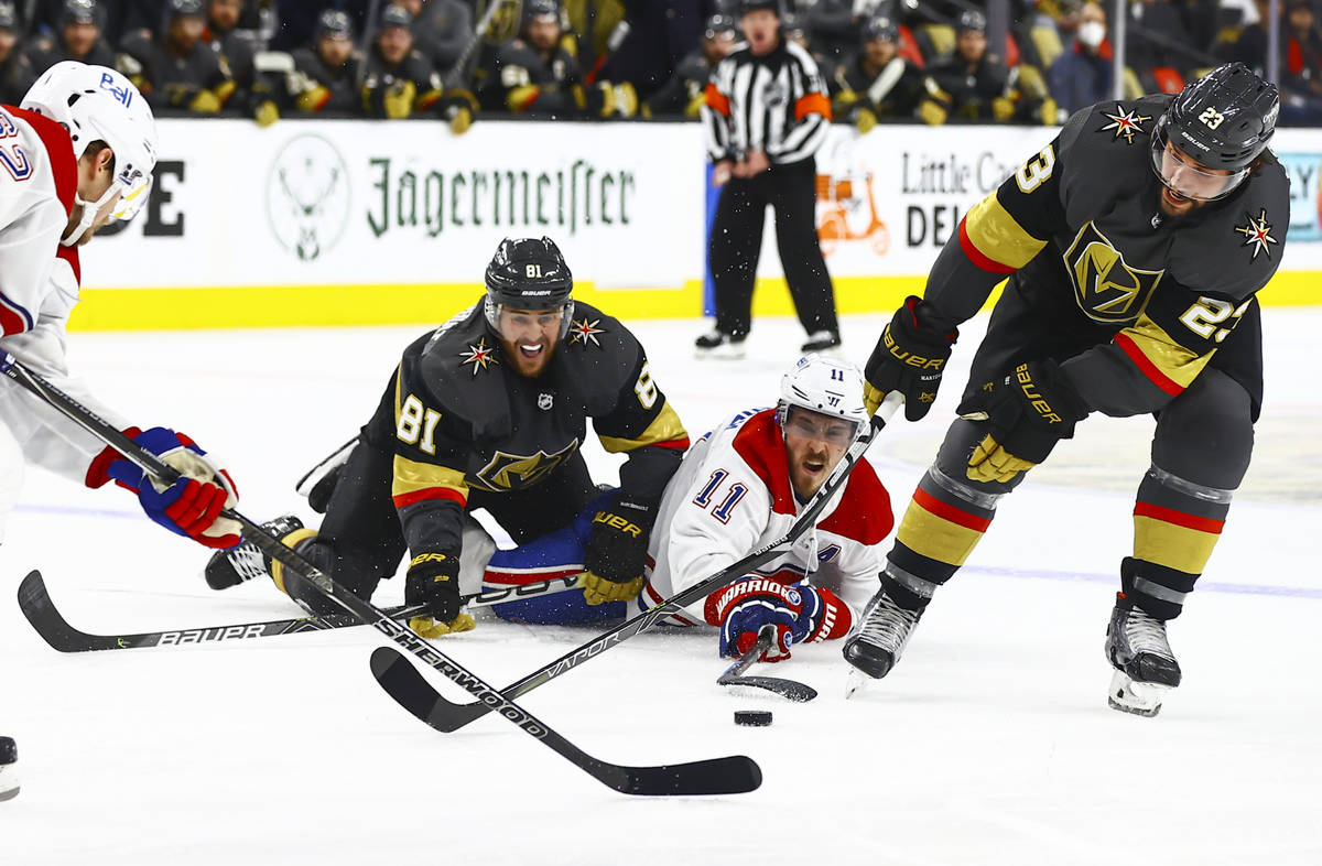 Montreal Canadiens' Brendan Gallagher (11) battles for the puck against Golden Knights' Jonatha ...