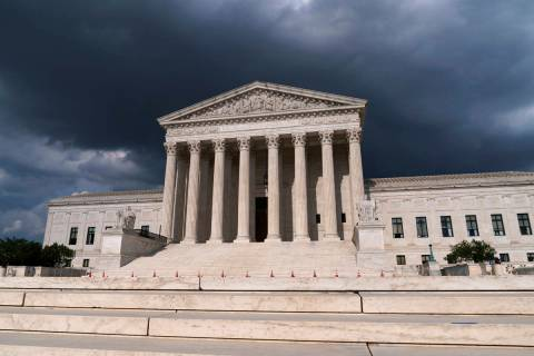 In this June 8, 2021 photo, with dark clouds overhead, the Supreme Court is seen in Washington. ...