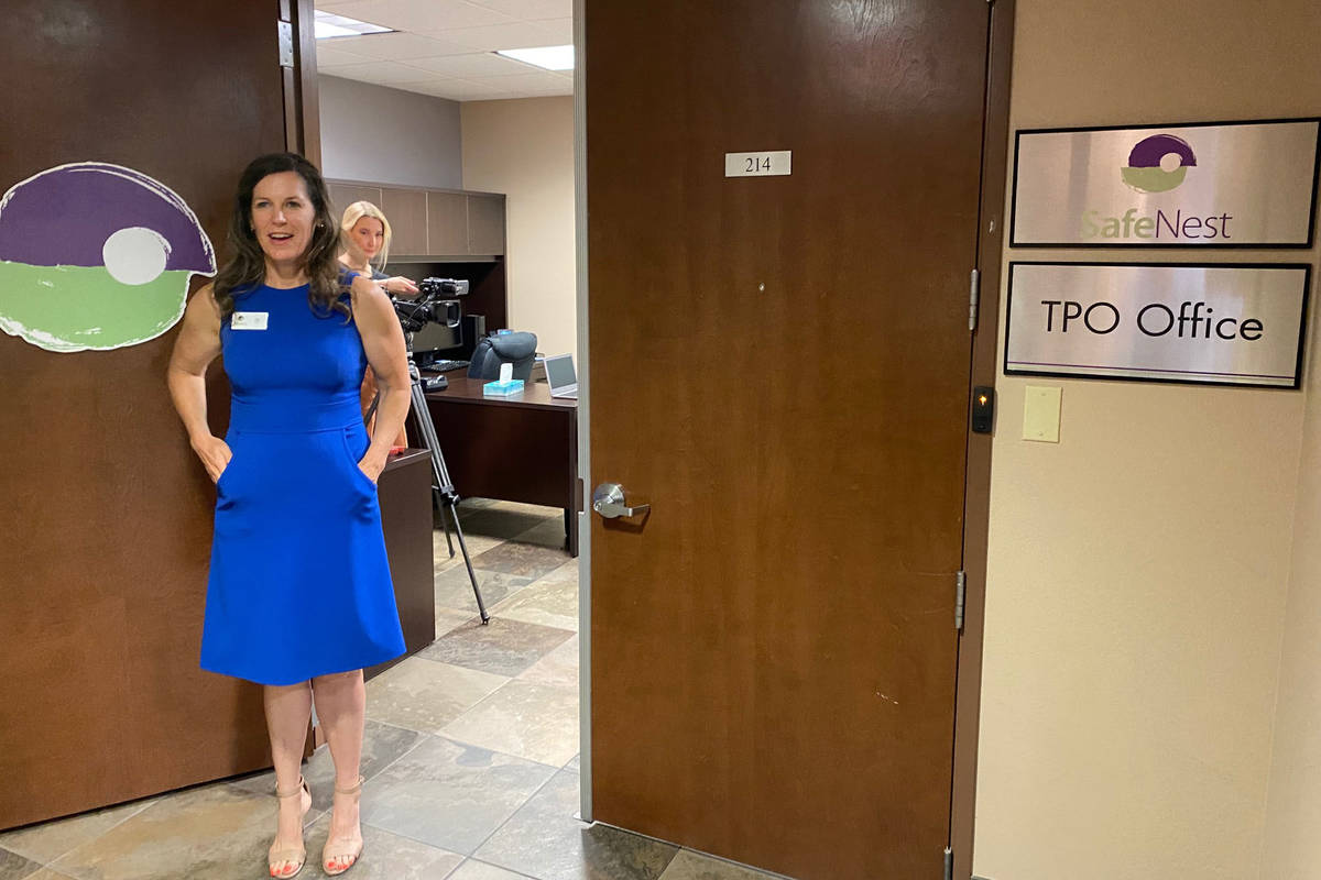 SafeNest CEO Liz Ortenburger stands outside the domestic violence shelter's new temporary prote ...