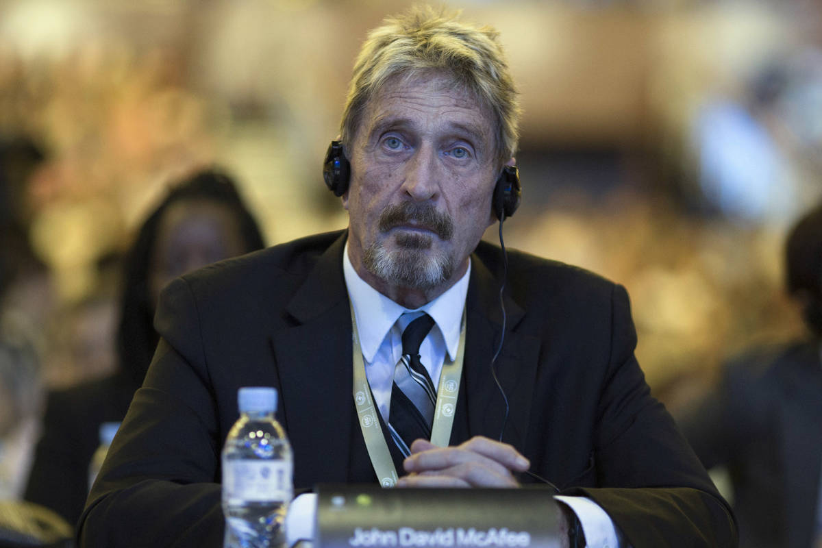 FILE - In this Tuesday, Aug. 16, 2016 file photo, software entrepreneur John McAfee listens dur ...