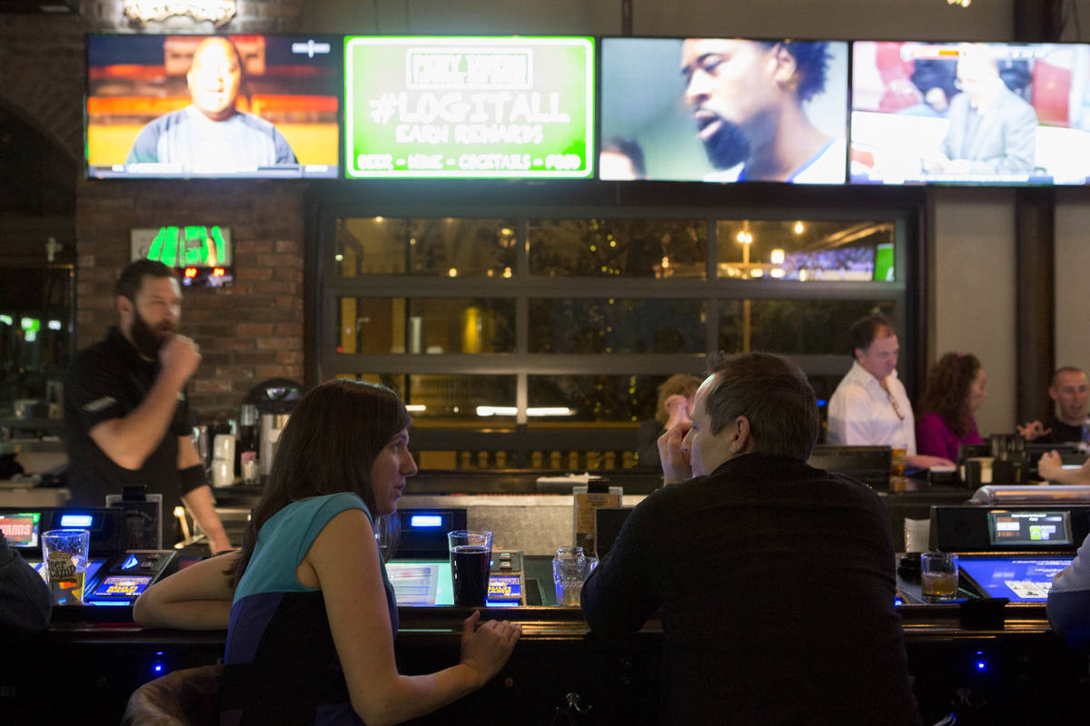 Patrons enjoy their drinks at PKWY Tavern on Friday, Feb. 10, 2017, in Las Vegas. Two new PKWY ...