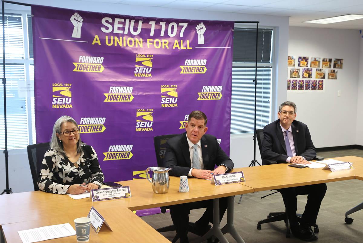 U.S. Secretary of Labor Marty Walsh, center, meets with SEIU Local 1107 labor union members inc ...