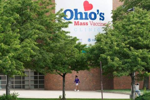 A man walks by the entrance for Ohio's COVID-19 mass vaccination clinic at Cleveland State Univ ...