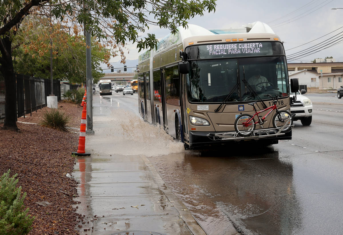 A Regional Transportation Commission bus drives through standing water after a light rain on Ch ...