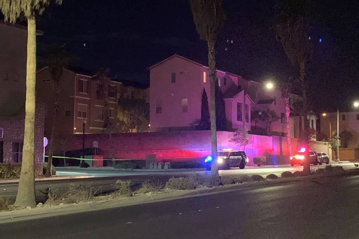 Las Vegas police investigate a homicide in a neighborhood near Elkhorn Road in the northwest va ...