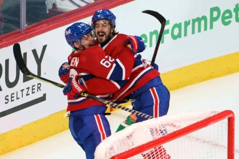 Montreal Canadiens' Artturi Lehkonen (62) celebrates his game-winning goal with teammate Philli ...