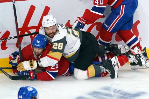 Vegas Golden Knights' William Carrier (28) falls on Montreal Canadiens' Jeff Petry (26) during ...