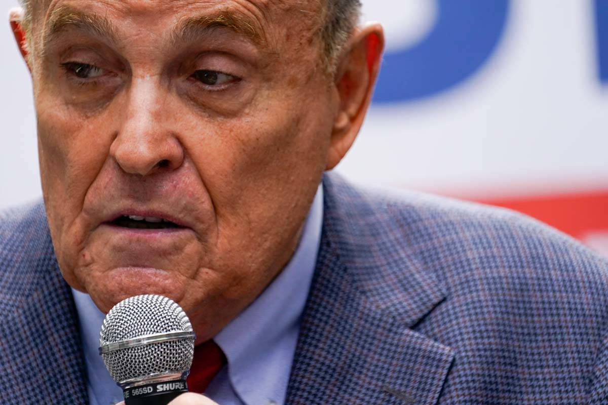 In this June 21, 2021, file photo former New York City Mayor Rudy Giuliani speaks during a camp ...