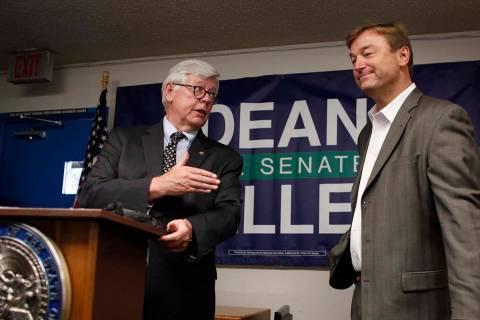 National Rifle Association President David Keene, left, announces the NRA's endorsement of Sen. ...