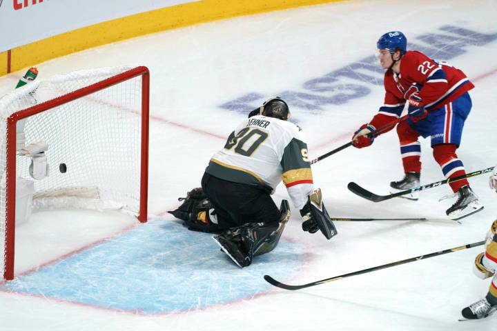 Montreal Canadiens' Cole Caufield (22) scores past Vegas Golden Knights goaltender Robin Lehner ...