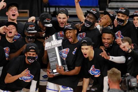 UC Santa Barbara players celebrate their NCAA Big West Conference tournament championship win o ...