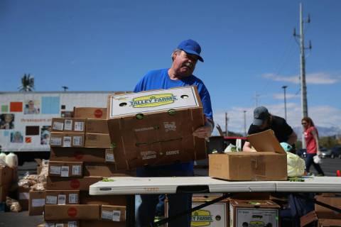 In this April 2, 2020, file photo, Three Square Food Bank volunteer John Castillo organizes foo ...