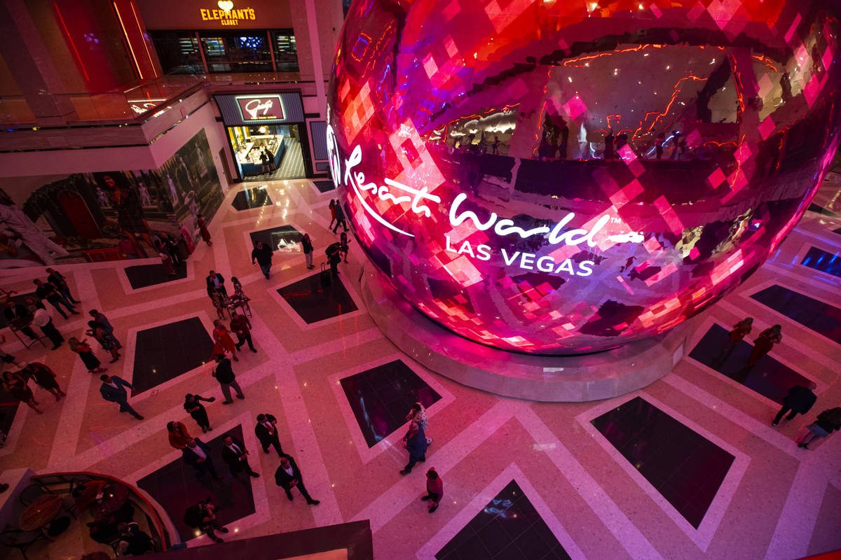 People walk around The District during the opening night of Resorts World Las Vegas on Thursday ...