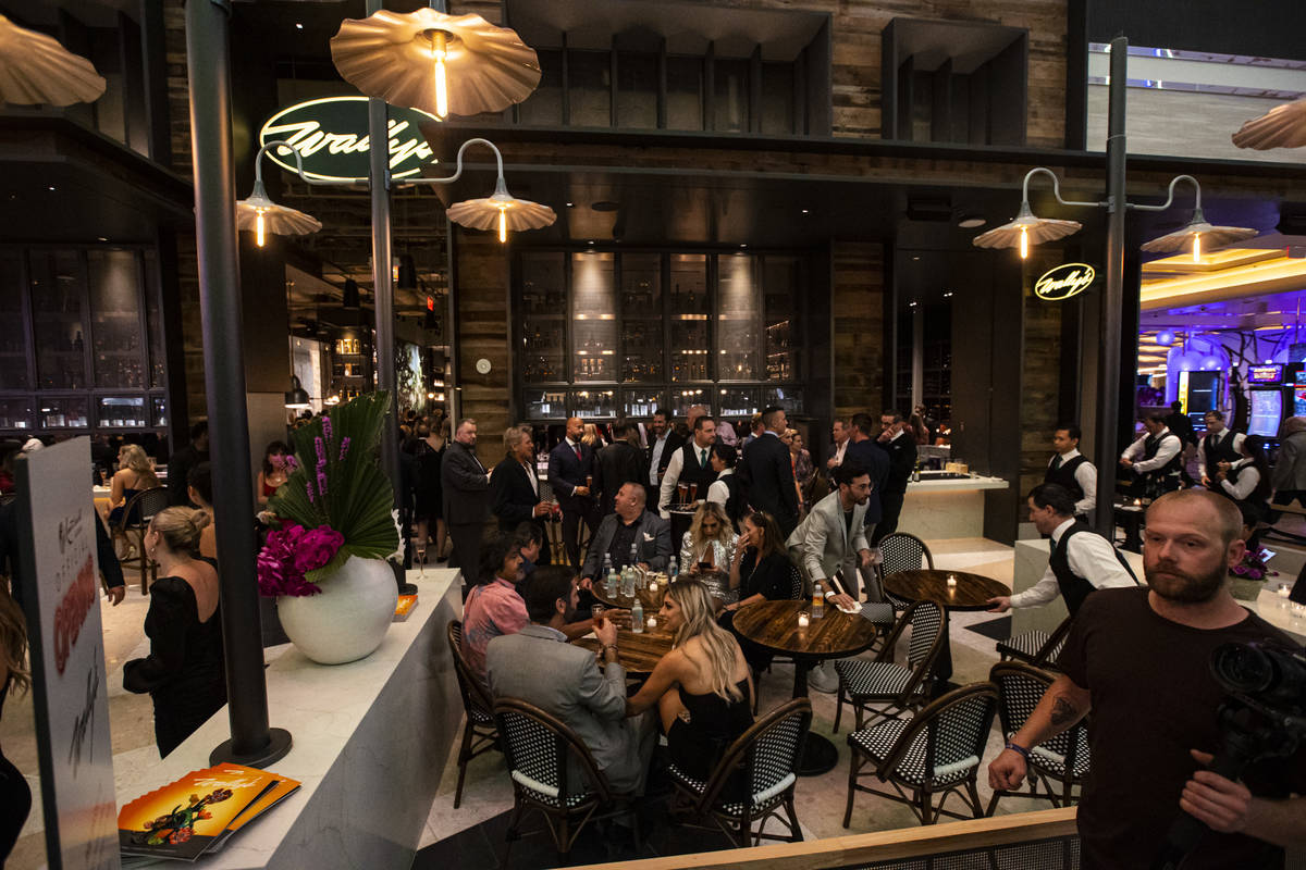 People drink and mingle at WallyÕs during the opening night of Resorts World Las Vegas on ...