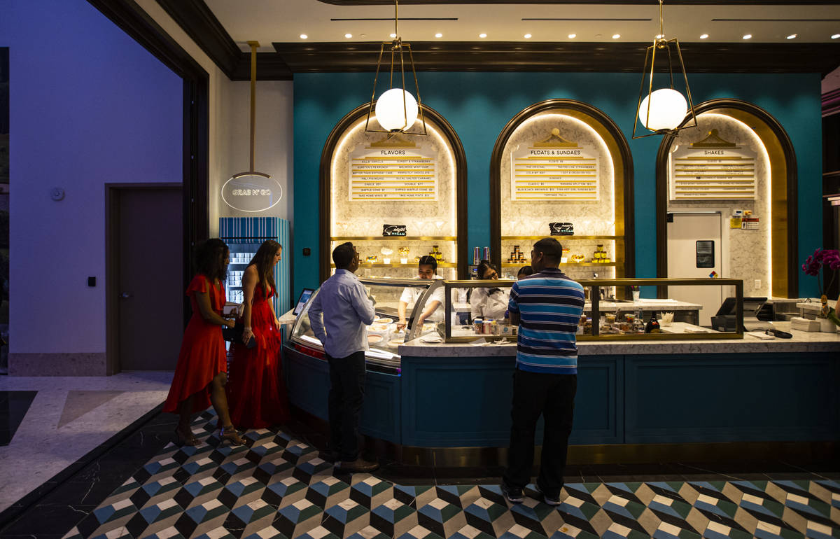People check out offerings from CraigÕs Vegan ice cream at The District during the opening ...