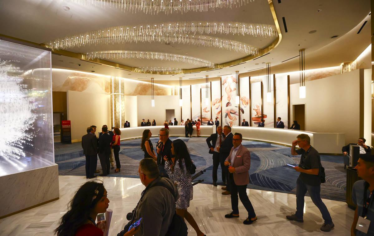 People walk through the Conrad hotel lobby during the opening night of Resorts World Las Vegas ...