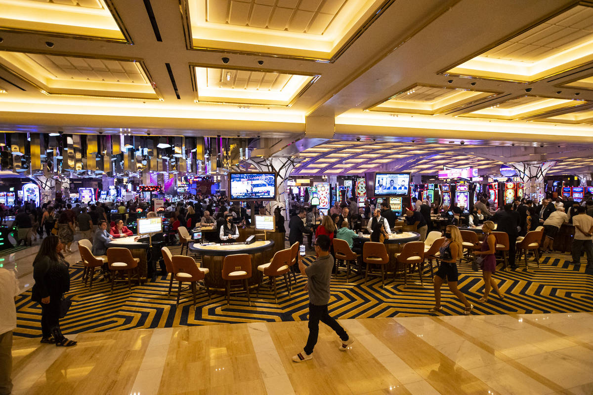 People walk by the casino floor as Resorts World Las Vegas opens to the public on Thursday, Jun ...