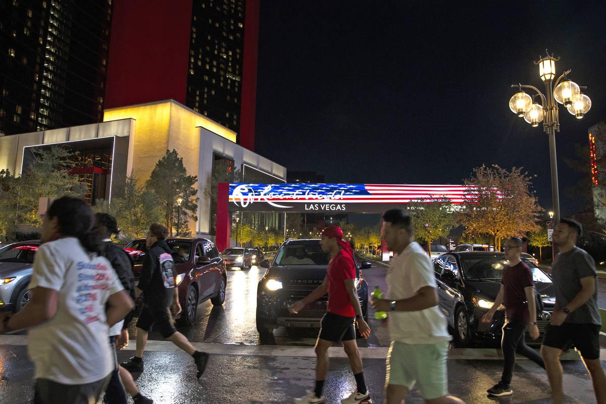 Pedestrians cross Las Vegas Boulevard at Resorts World Avenue outside Resorts World Las Vegas o ...