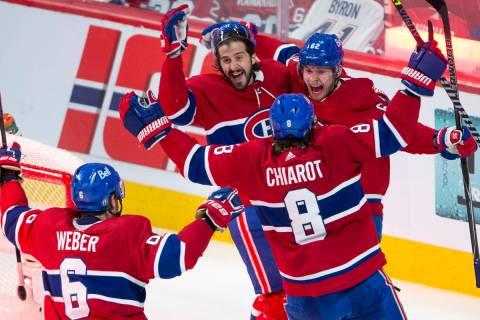 Montreal Canadiens left wing Artturi Lehkonen (62) celebrates with teammates after scoring the ...