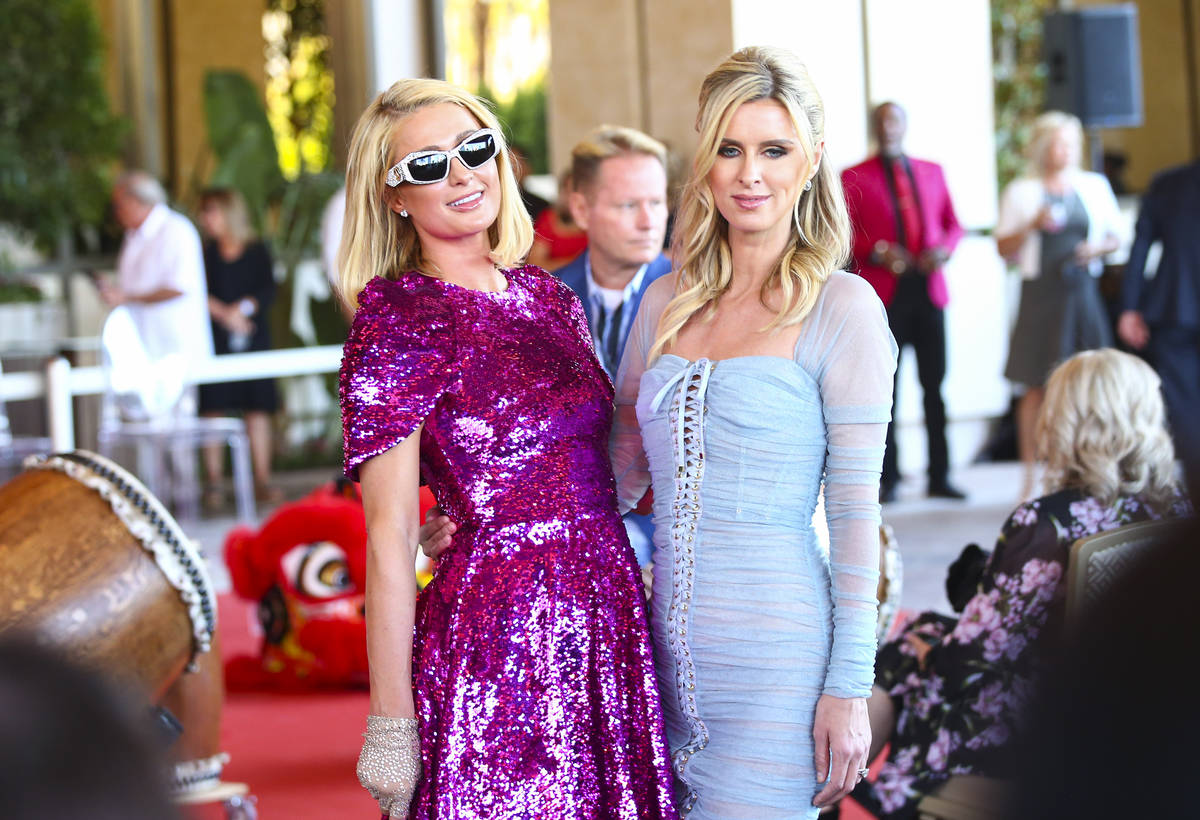 Paris Hilton, left, and Nicky Hilton arrive for the ribbon-cutting ceremony to mark the opening ...