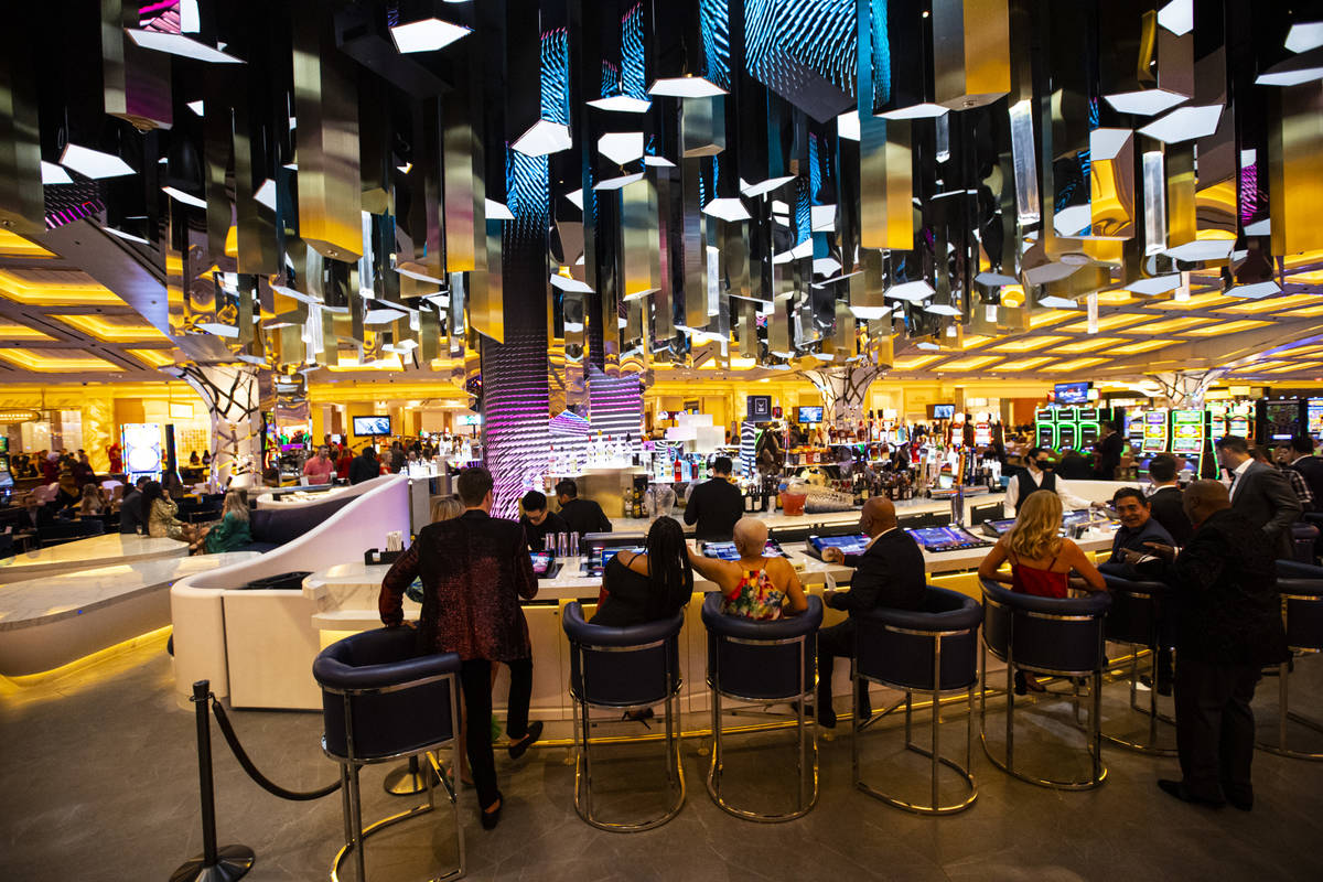 People mingle at the Crystal Bar during the opening night of Resorts World Las Vegas on Thursda ...