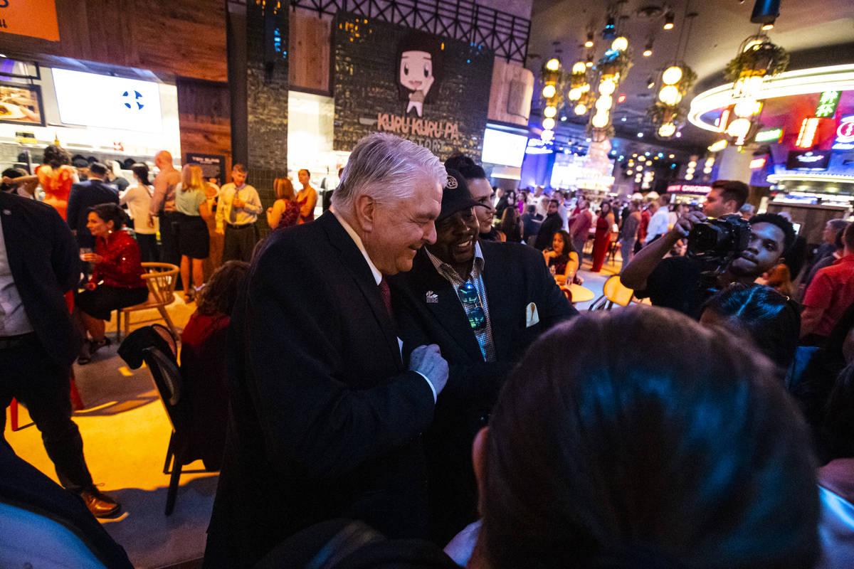 Gov. Steve Sisolak greets attendees during the opening night of Resorts World Las Vegas on Thur ...