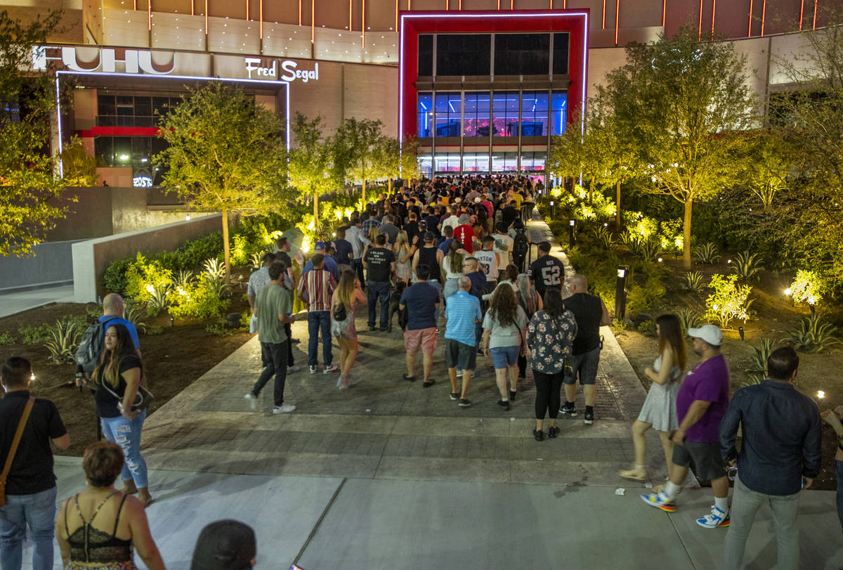 A large crowd gathers to enter for the Resorts World Las Vegas grand opening along the Strip on ...