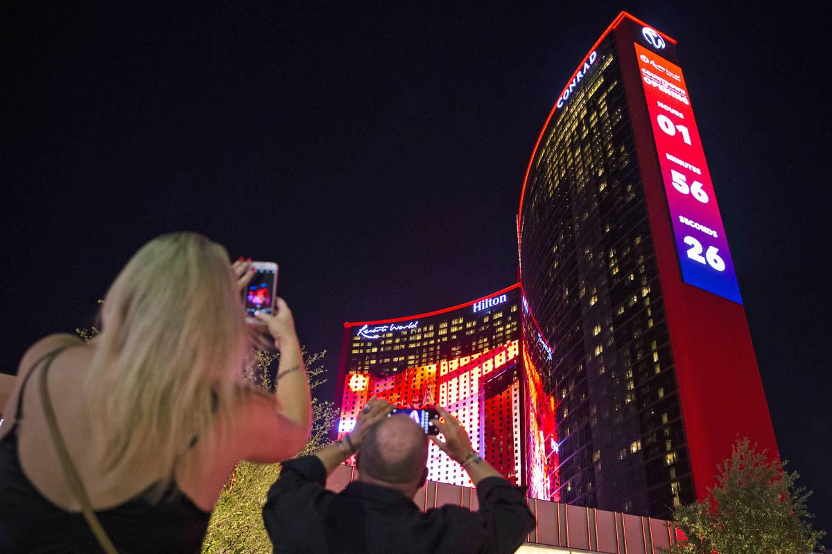 Beth Burdick, left, and Mark Gierth, both of Las Vegas, photograph Resorts World Las Vegas on T ...
