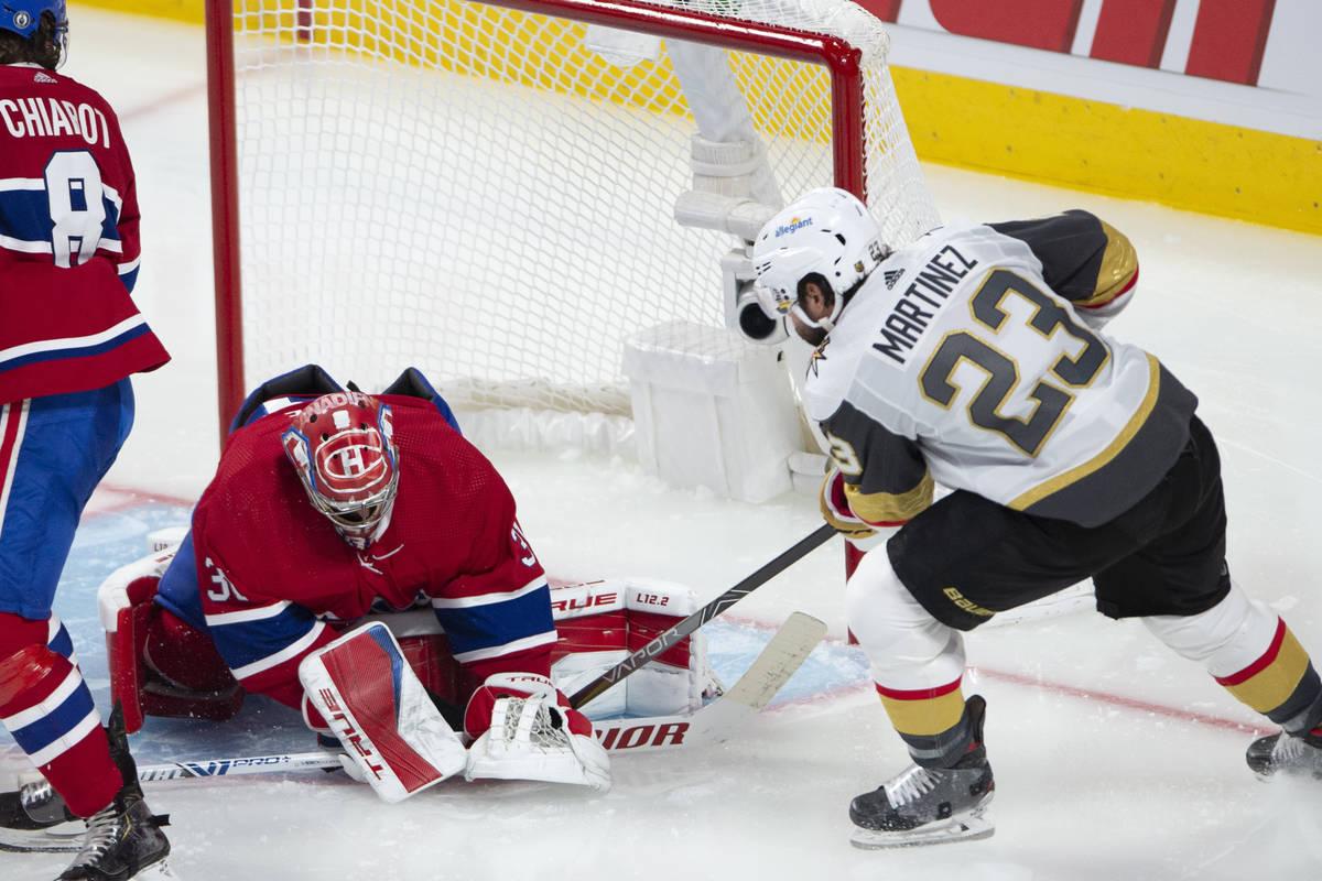 Vegas Golden Knights' Alec Martinez (23) scores on Montreal Canadiens goaltender Carey Price (3 ...