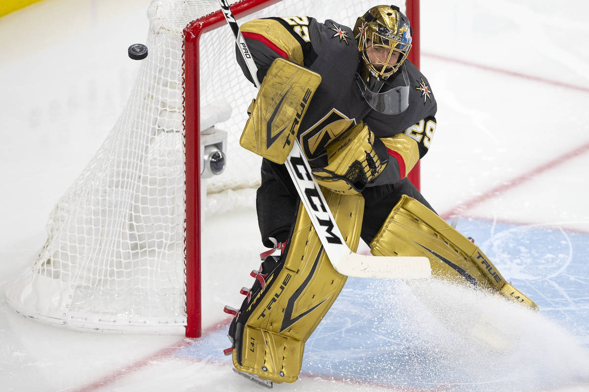 Golden Knights goaltender Marc-Andre Fleury (29) makes a save during the second period of Game ...