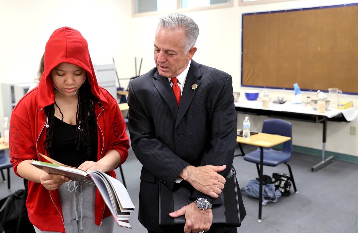 Clark County Sheriff Joe Lombardo meets with student Savanah Mcfarlin, 15, before announcing hi ...