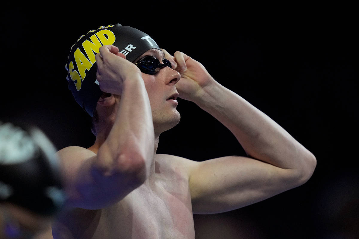 Bowe Becker gets ready to compete in the men's 50-meter freestyle final during wave 2 of the U. ...
