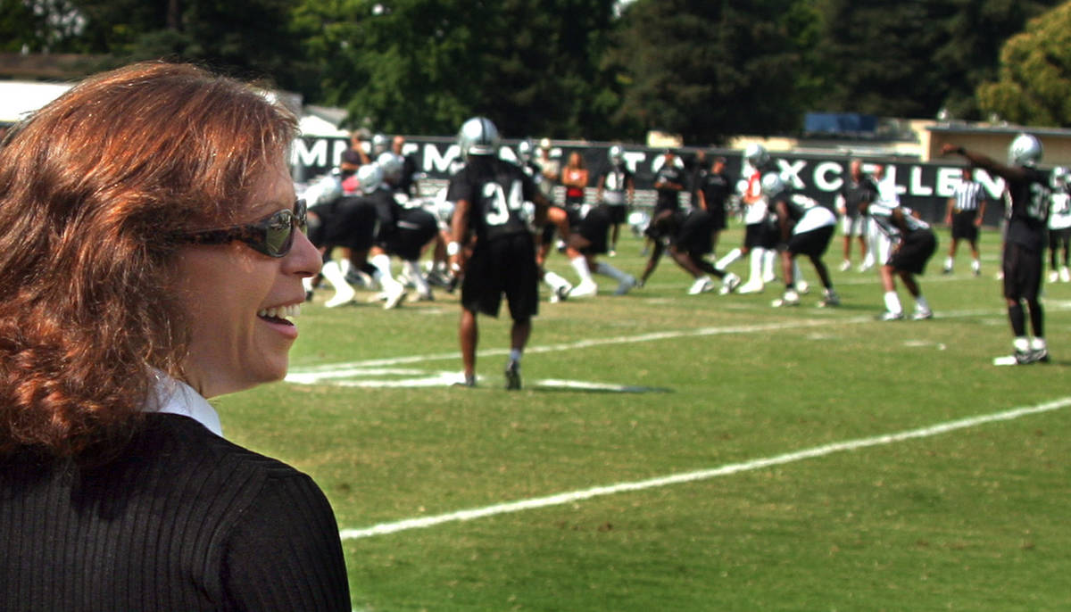 Amy Trask, Chief Executive of the Oakland Raiders, watches the team and talks with fans and com ...