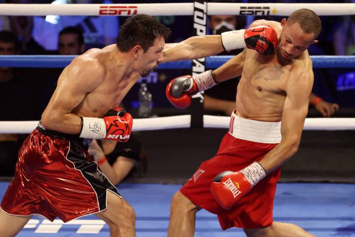 Janibek Alimkhanuly, left, connects a punch against Rob Brant, in the eight round of the middle ...