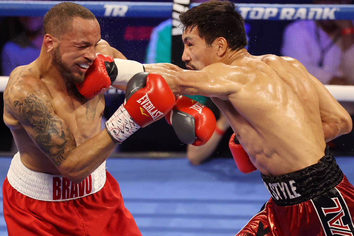 Janibek Alimkhanuly, right, connects a punch against Rob Brant, in the fourth round of the midd ...