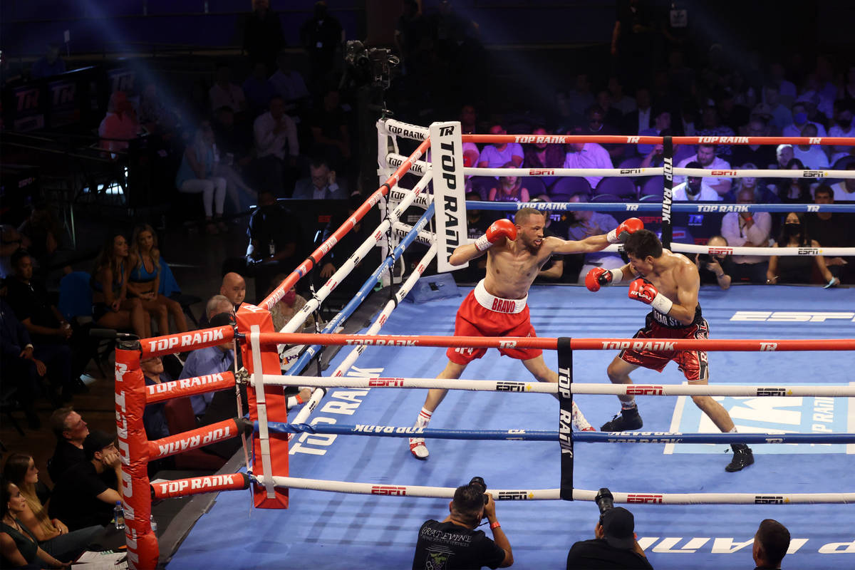 Rob Brant, left, and Janibek Alimkhanuly, battle in the third round of the middleweight bout at ...