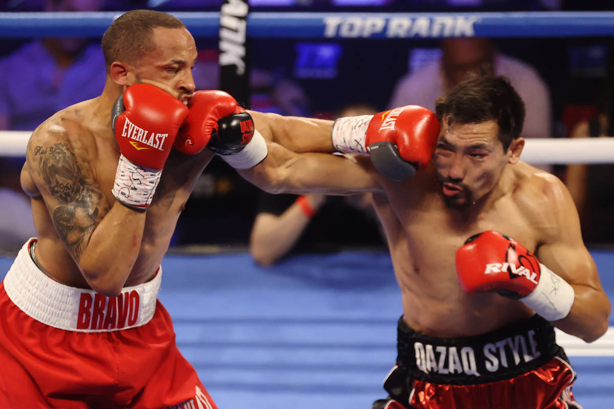 Rob Brant, left, and Janibek Alimkhanuly, battle in the second round of the middleweight bout a ...