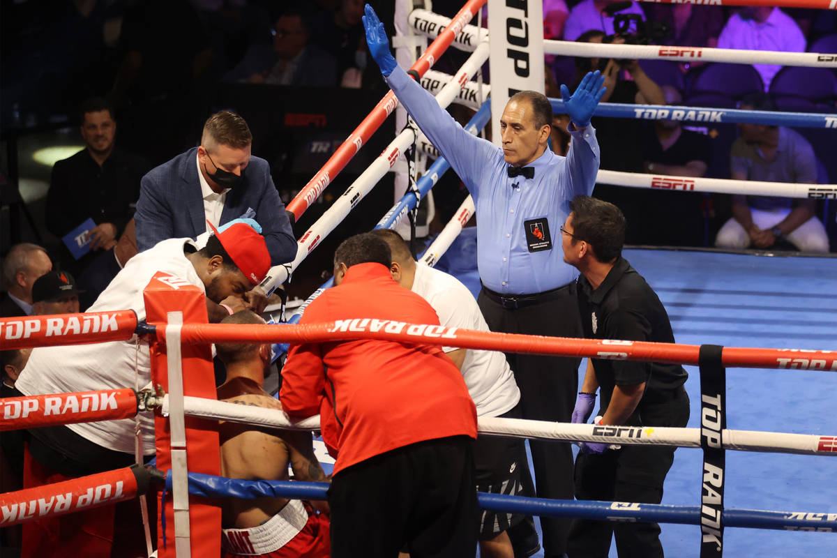 The referee signals the end of the fight at the end of the eight round after the team of Rob Br ...