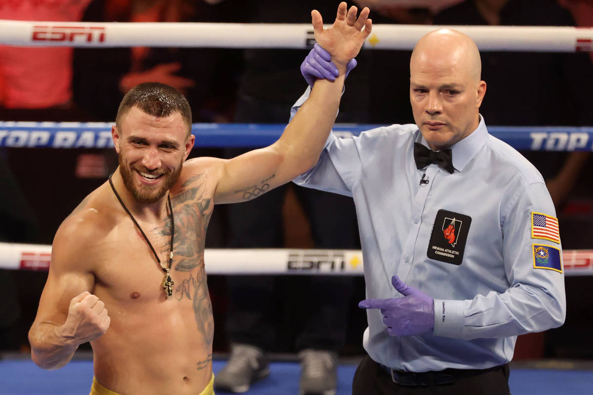 Vasyl Lomachenko poses after winning by way of technical knockout in a lightweight bout against ...