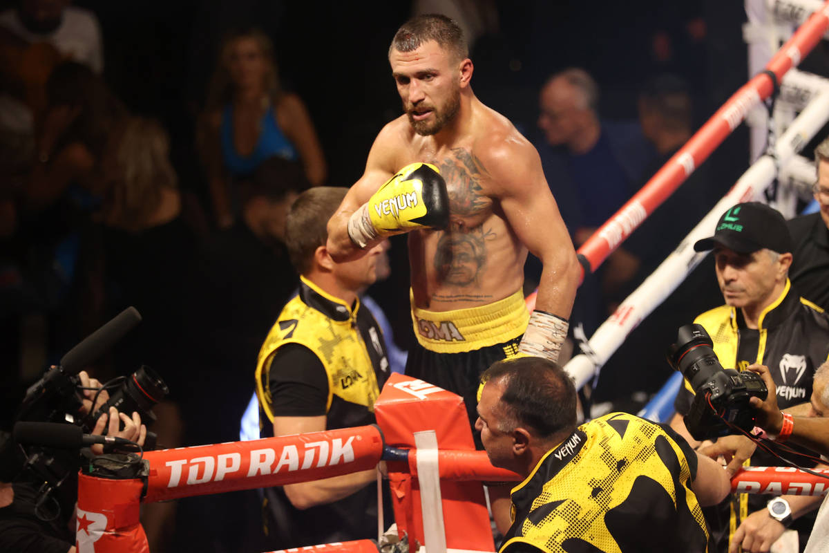Vasyl Lomachenko celebrates after winning by way of technical knockout in a lightweight bout ag ...