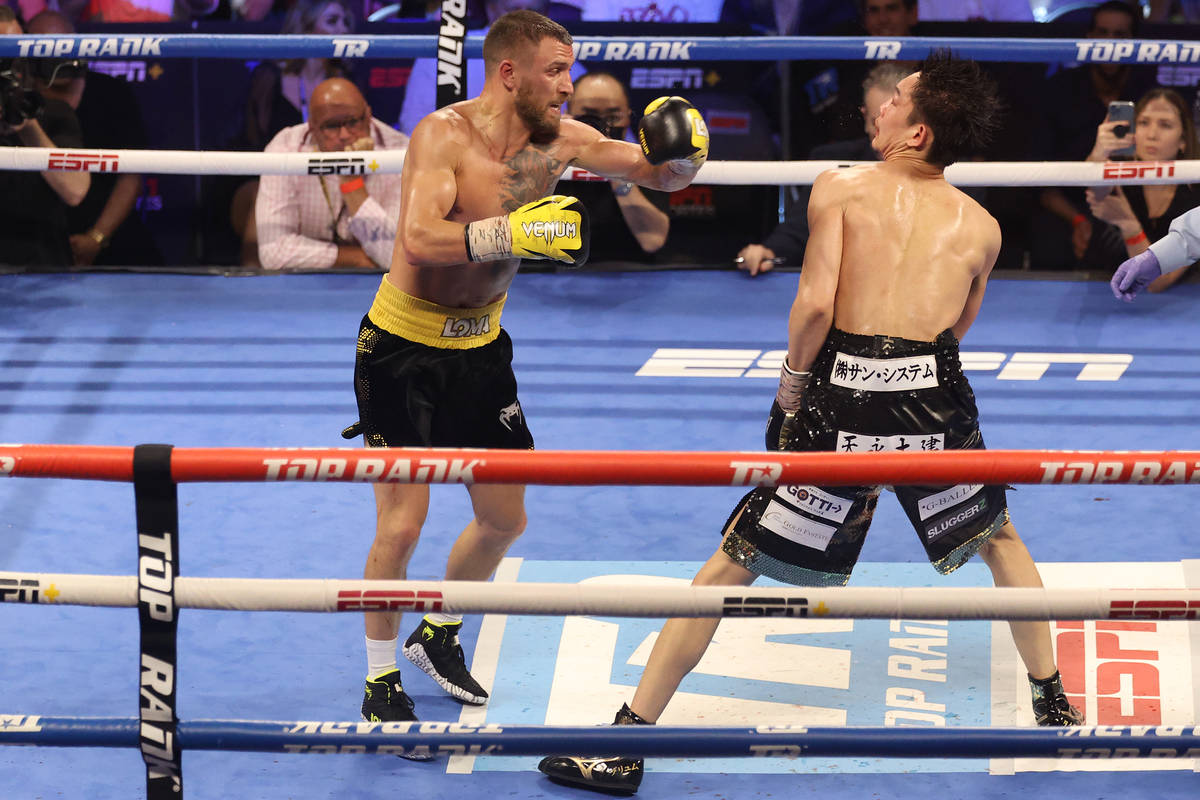 Vasyl Lomachenko, left, connects a punch against Masayoshi Nakatani in the ninth round of the l ...