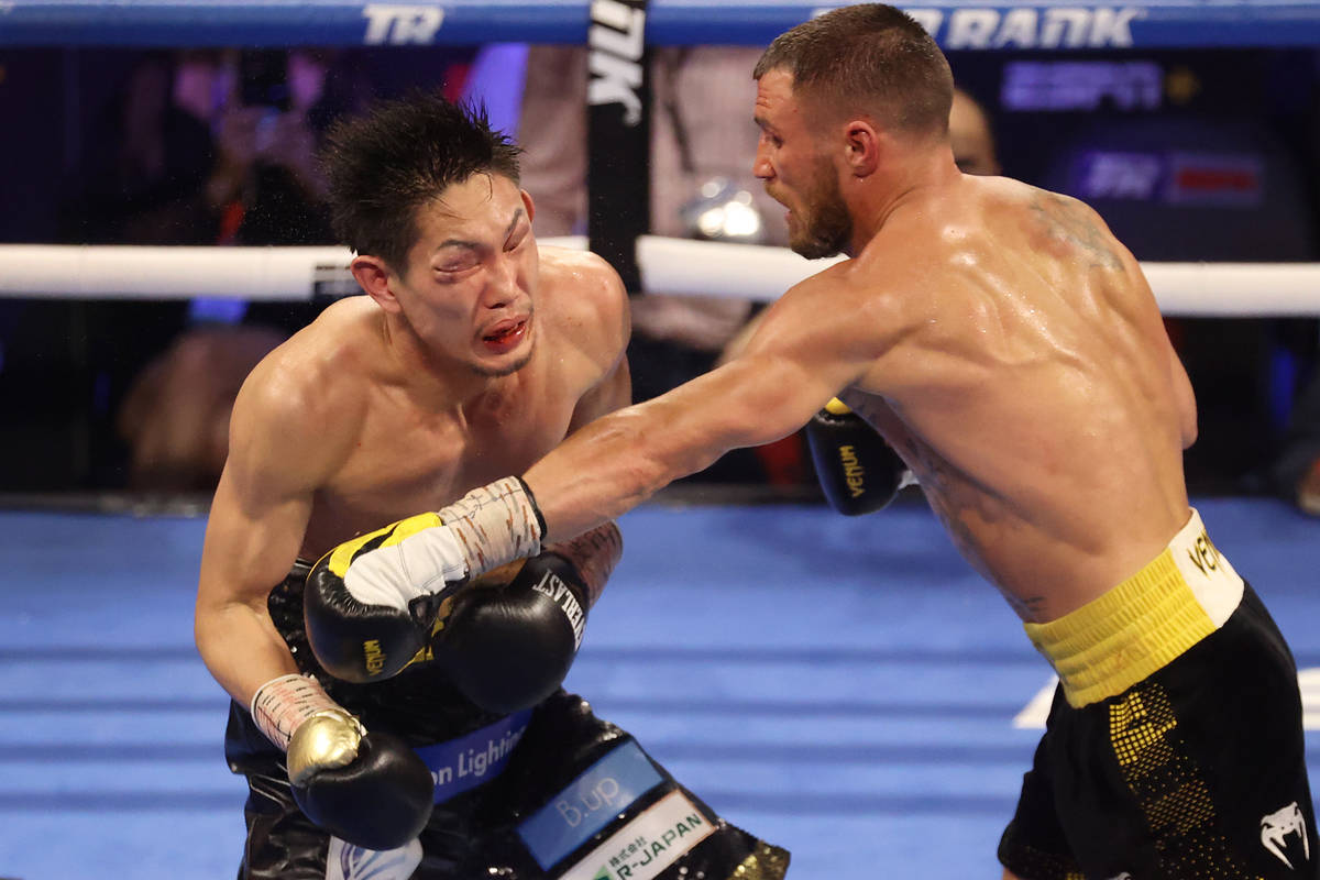 Vasyl Lomachenko, right, connects a punch against Masayoshi Nakatani in the ninth round of the ...