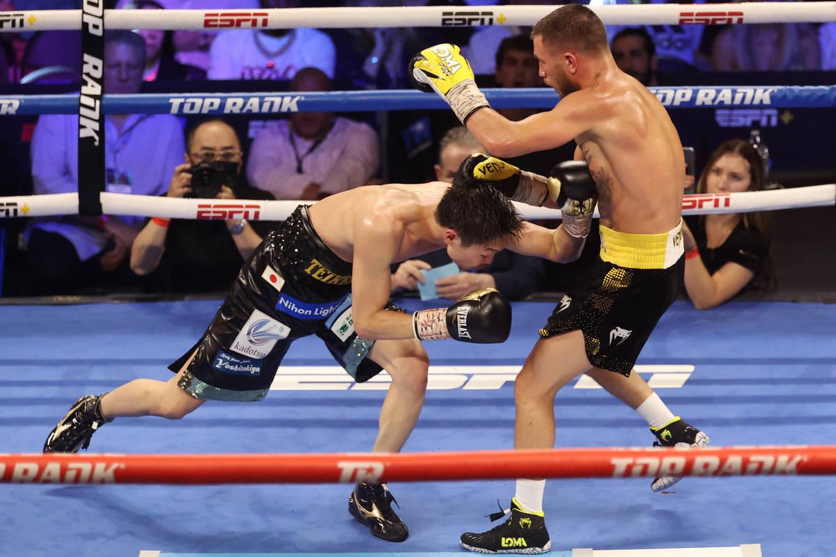 Masayoshi Nakatani, left, battles Vasyl Lomachenko in the ninth round of the lightweight bout a ...