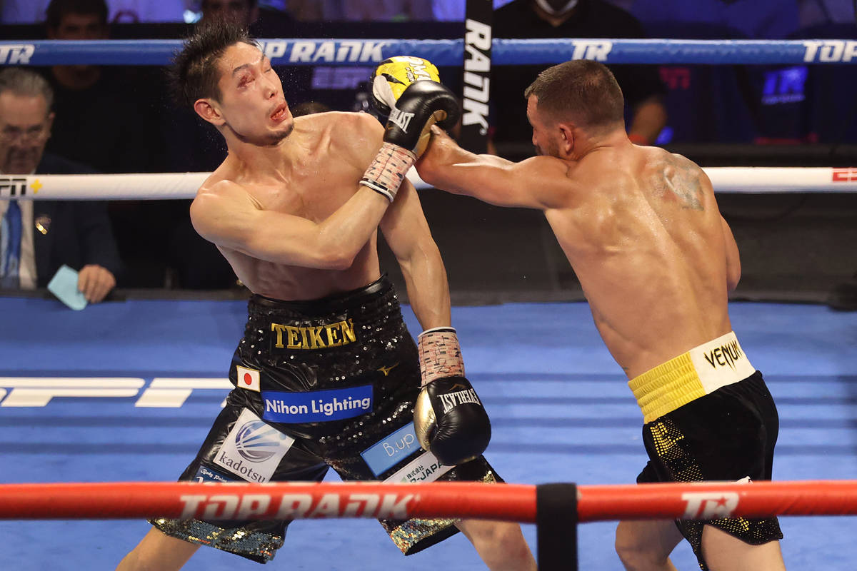 Vasyl Lomachenko, right, connects a punch against Masayoshi Nakatani in the seventh round of th ...