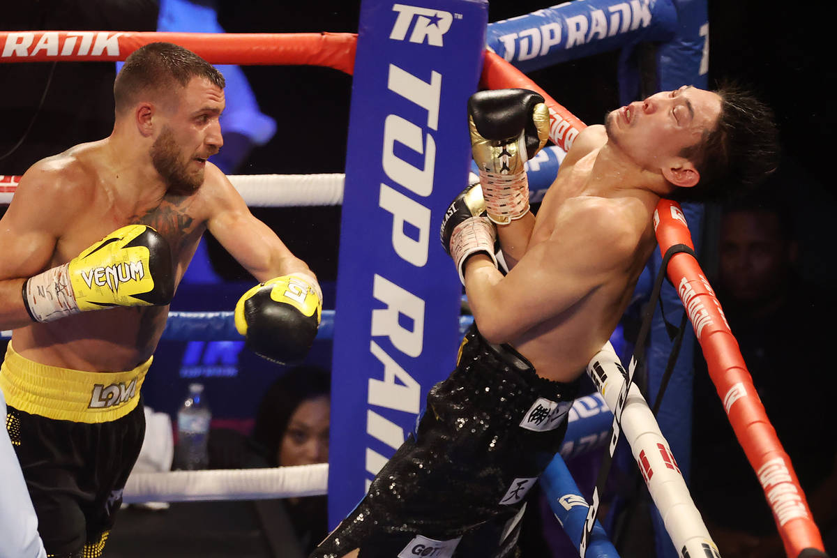 Vasyl Lomachenko, left, connects a punch against Masayoshi Nakatani in the sixth round of the l ...