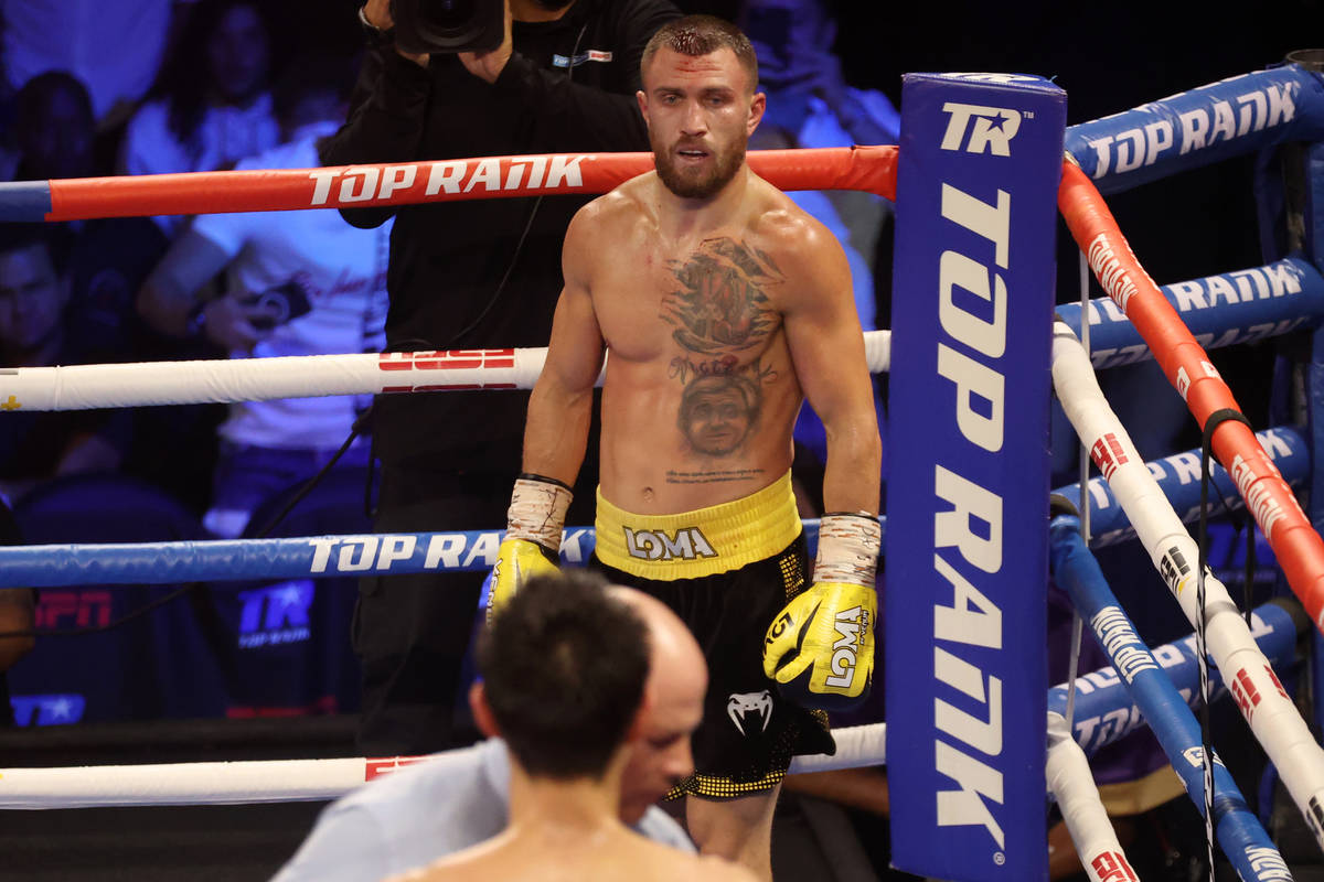 Vasyl Lomachenko looks on after knocking down Masayoshi Nakatani in the fifth round of the ligh ...