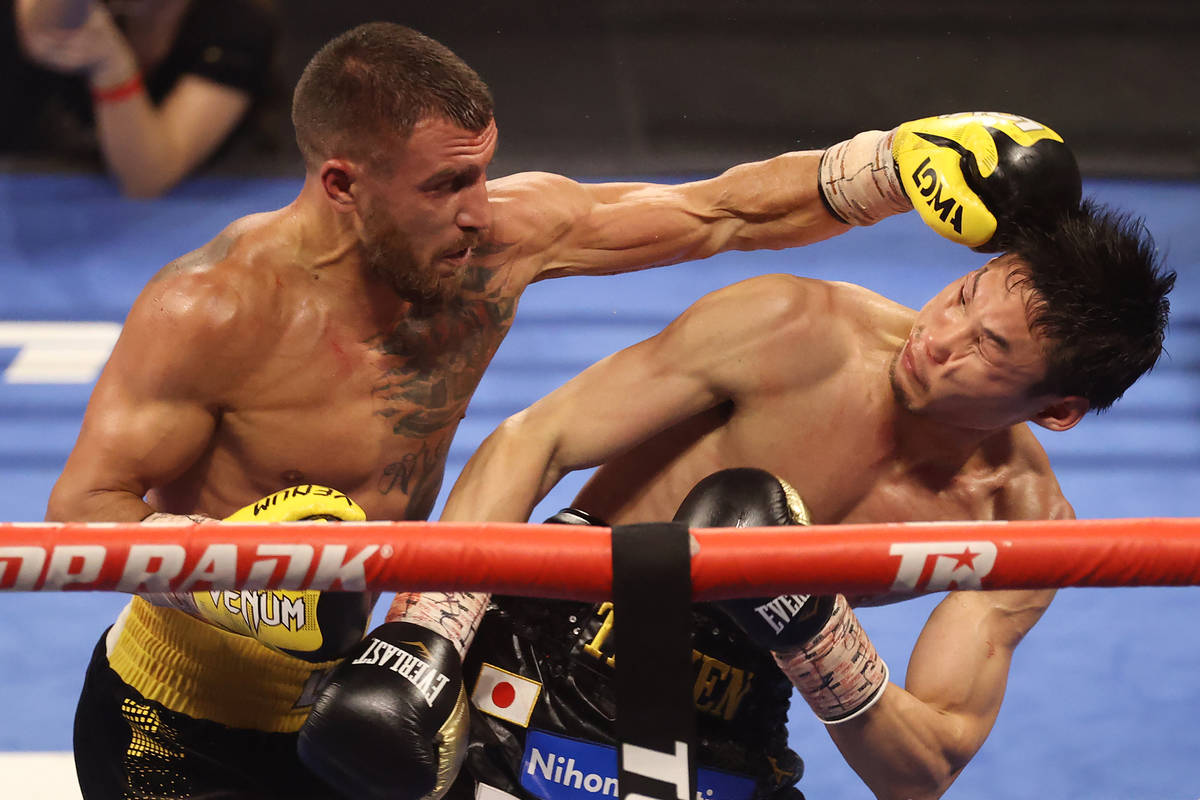 Vasyl Lomachenko, left, connects a punch against Masayoshi Nakatani in the fifth round of the l ...